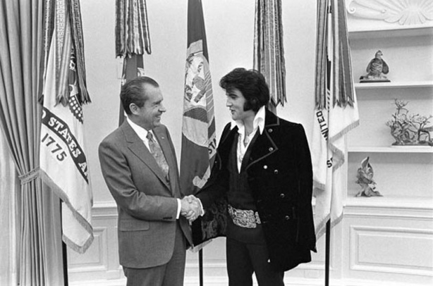 President Nixon shakes hands with Elvis Presley in the Oval Office
